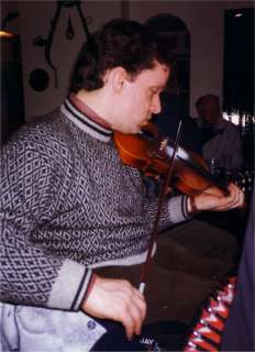 Playing Fiddle in a pub session